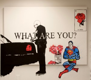 Painting on wall and canvas titled What Are You?
