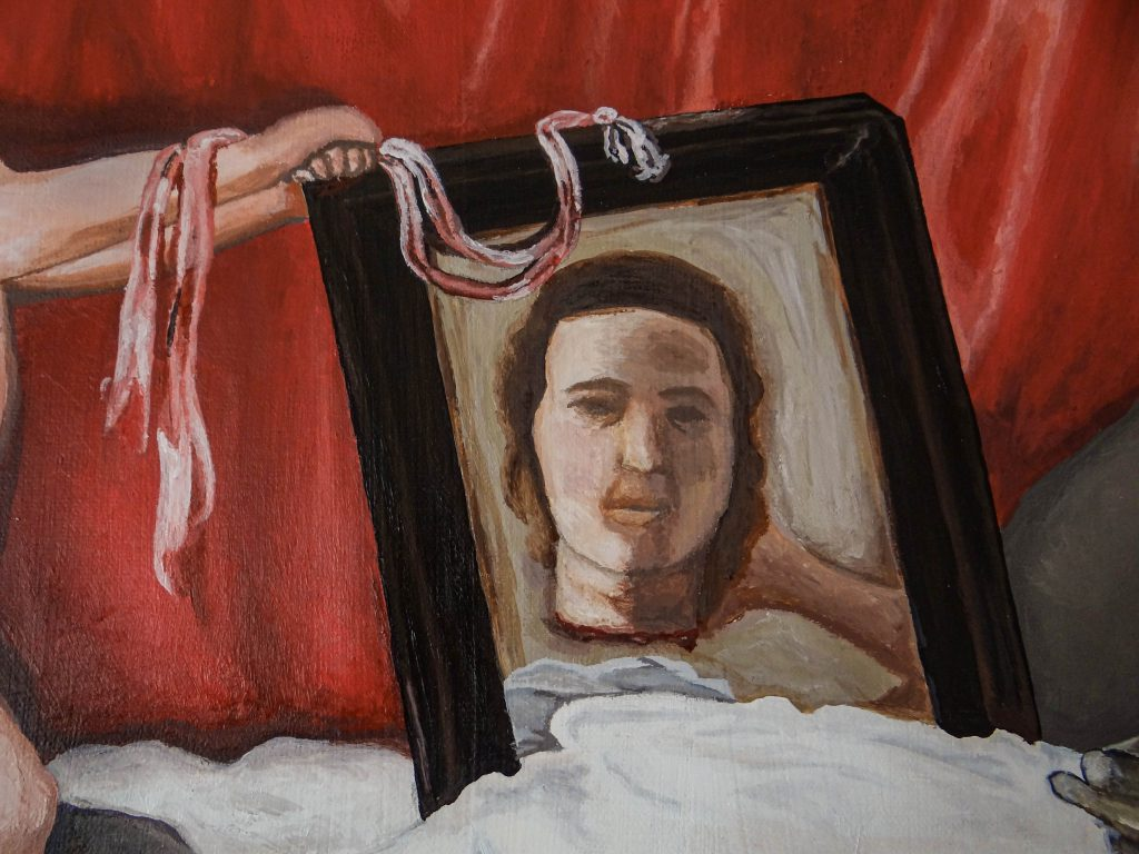A detail of the mirror reflecting a severed head